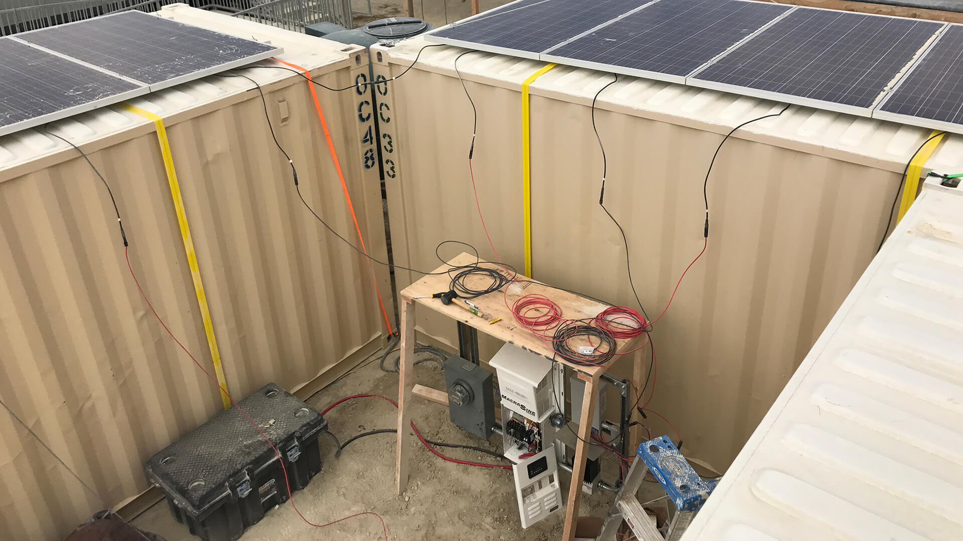 Wiring up the solar array to the inverter and SimpliPhi batteries which are located in the sealed black strongbox.